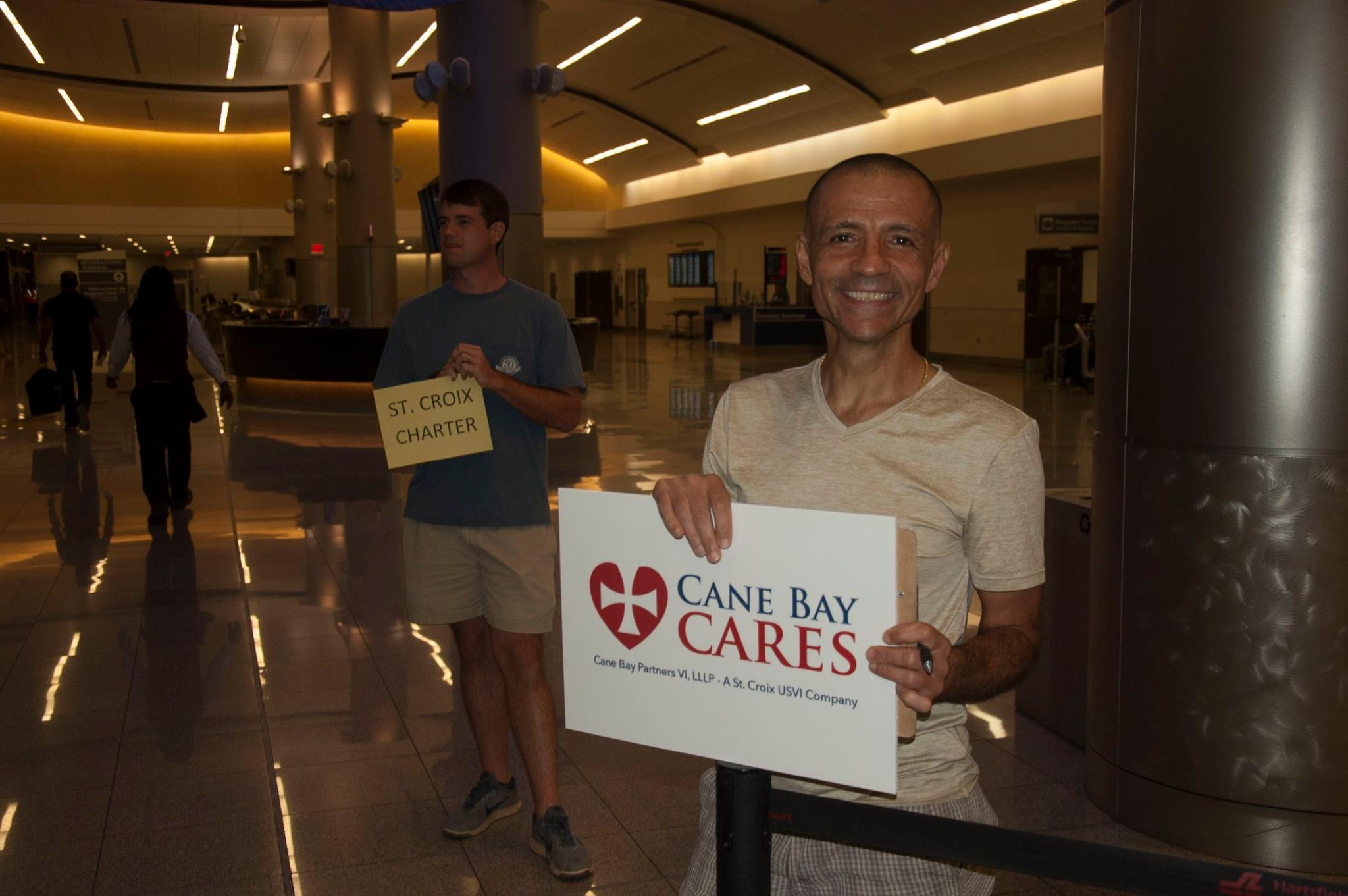 Cane Bay Partners Employees Volunteer To Greet Fellow Employees And Other Evacuees From St. Croix To Altanta.