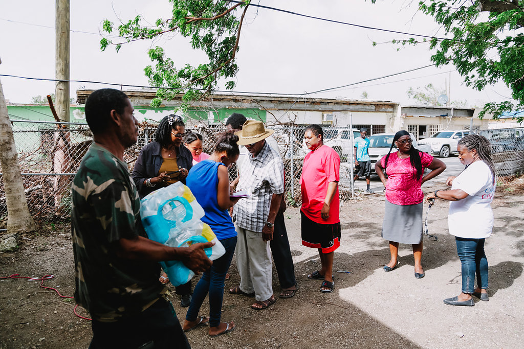 Cane Bay Cares Distributes Water At The Boys And Girls Club In Frederiksted In The Aftermath Of Hurricane Maria. Photo Credit: Http://nicolecanegata.com/